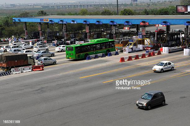 Farmers staged a protest demanding roll back of toll hike by DelhiNoida Direct flyway on April 2 2013 in Noida India Two wheelers toll rates have...