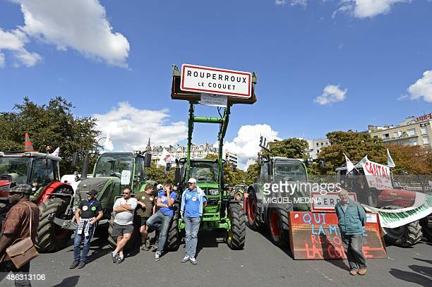 Farmers stand by tractors on Place de la Nation in Paris during a national demonstration on September 3 to protest against the falling prices that...