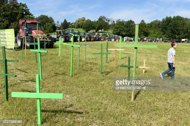 Farmers stand in front of tractors during a protest against the agricultural policy of the federal government on July 14, 2020 in Bernau, southern...