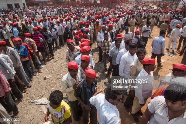 Farmers stand in queue to take free lunch during farmers protest march at Azad Maidan on March 12 2018 in Mumbai India Over 30000 farmers from across...