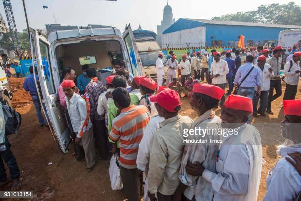 Farmers stand in queue to take free medicines during farmers protest march at Azad Maidan on March 12 2018 in Mumbai India Over 30000 farmers from...