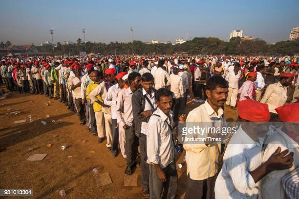 Farmers stand in queue to take free vada pav during farmers protest march at Azad Maidan on March 12 2018 in Mumbai India Over 30000 farmers from...