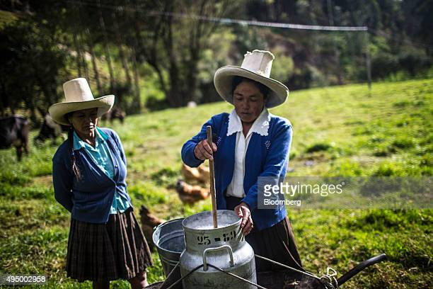 Farmers store milk to be sold after milking the cows beside the Chonta River near Cajamarca Peru on Friday Oct 2015 Local environmentalists claim the...