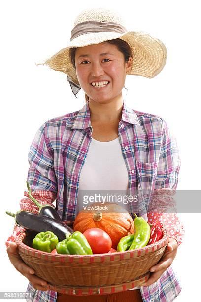 Farmers take a basket of vegetables