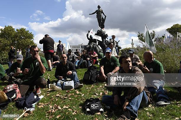 Farmers take a break to lunch during a national demonstration in Place de la Nation in Paris on September 3 to protest against the falling prices...