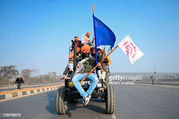 Farmers take part in a tractor rally as they continue to demonstrate against the central government's recent agricultural reforms in New Delhi on...