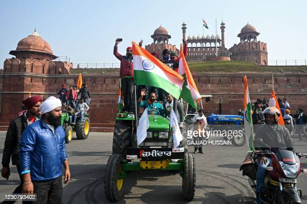 Farmers take part in a tractor rally as they continue to protest against the central government's recent agricultural reforms, in front of Red Fort...