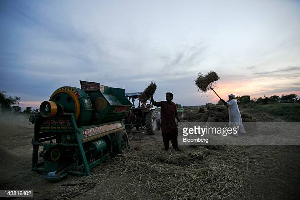 Farmers thresh wheat during a harvest in the village of Fatehganj in Punjab province Pakistan on Thursday May 3 2012 Pakistan is Asia's thirdlargest...
