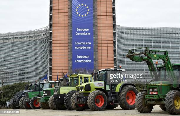 TOPSHOT Farmers tractors are parked outside a building during a meeting of European Union Agriculture Ministers at EU headquarters in Brussels on...