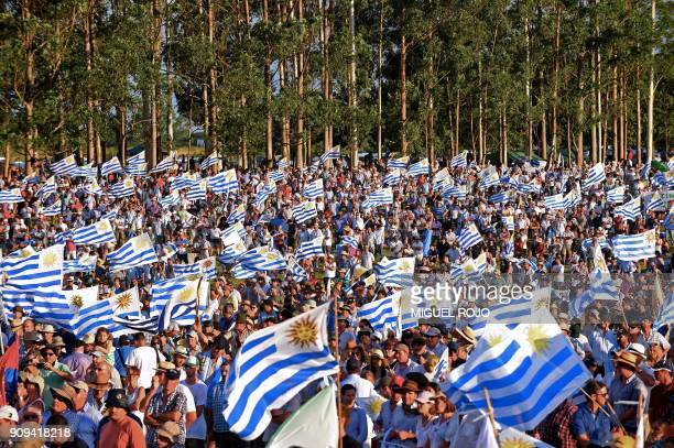 TOPSHOT Farmers traders and haulage contractors holding Uruguayan flags gathered to claim tax reliefs to President Tabaré Vazquez's government in...