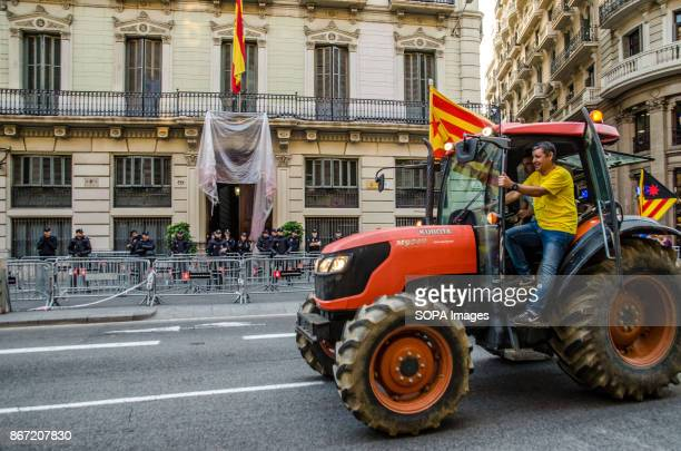Farmers Union tractor passes in front of the headquarters of the Spanish national police to join the party that takes place in Plaça de Sant JaumeFew...