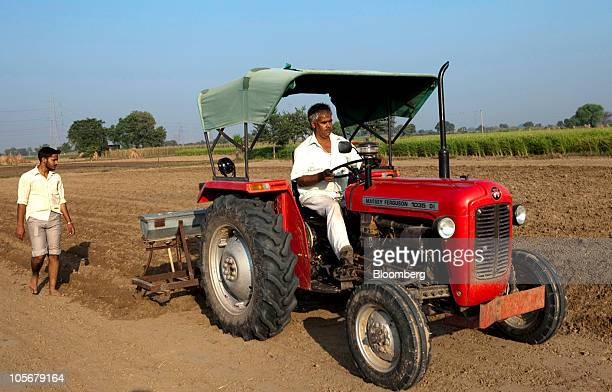Indian Farmer Tractor Stock Photos and Pictures | Getty Images