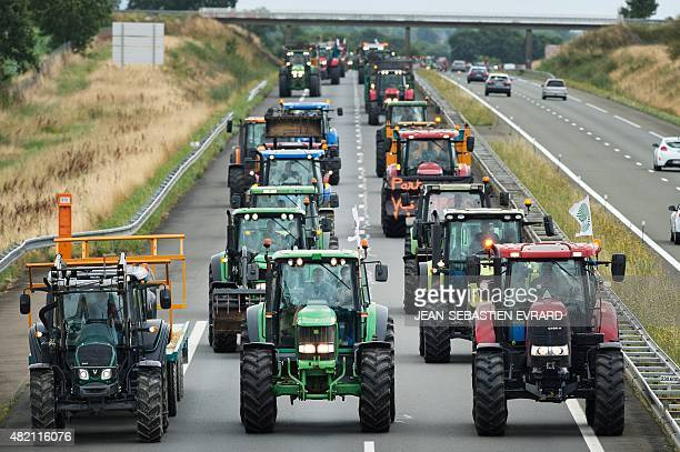 Farmers use tractors to block a highway near Laval during a demonstration against the market prices of their product on July 27 2015 in...