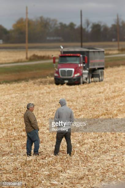 Farmers work on a corn field during a harvest at a farm near Carman Manitoba Canada on Saturday Oct 10 2020 Costs of staples slumped at the start of...