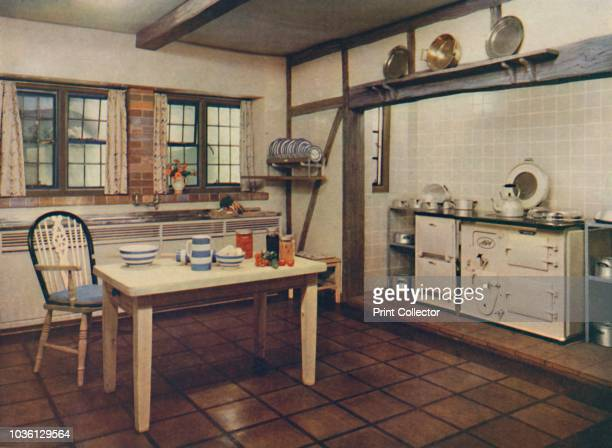 A farmhouse kitchen redesigned by Mrs Darcy Braddell London' 1936 Glazed tiles by Carter Co original oak stripped and treated cork tiles on floor...