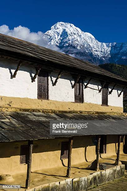 Farmhouse of the historical village with the mountain Annapurna South in the distance.