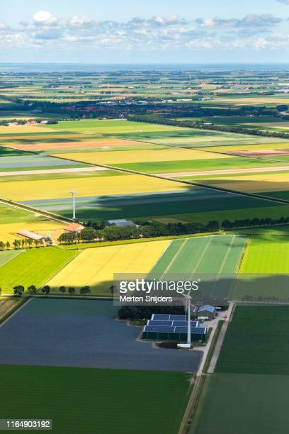 farmhouse with renewable energy facilities - merten snijders stock pictures, royalty-free photos & images