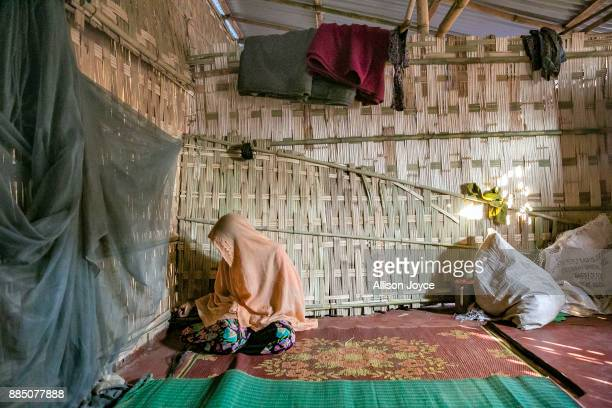 COX'S BAZAR BANGLADESH NOVEMBER 27 Farmina Begum sits on one side of a wall separating women from men on the day of her wedding to 18 year old...