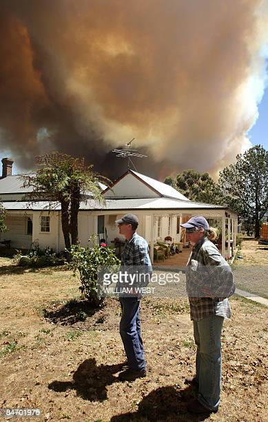 A farming couple monitor a giant fire raging in the Bunyip State Park near Labertouche some 125 kilometres west of Melbourne on February 7 2009 More...