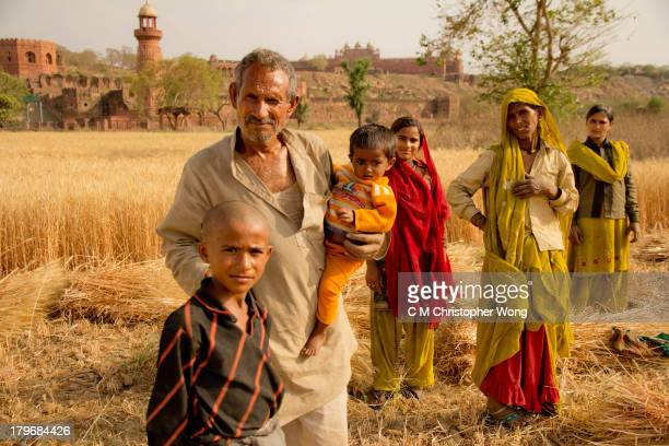 CONTENT] A farming family was harvesting wheat late afternoon sunset outside Fatehpur Sikri Agra district