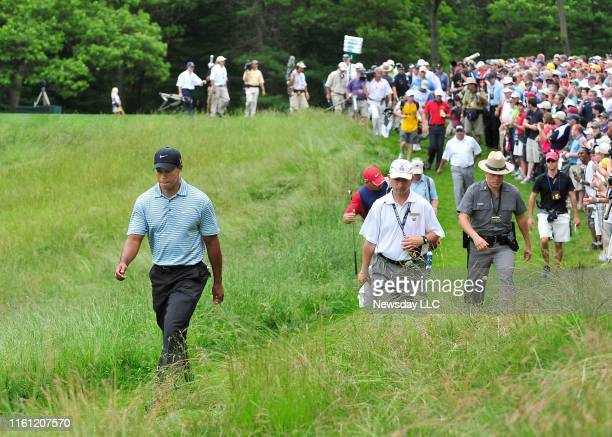 Farmingdale NY Tiger Woods walks through the rough down from the 14th tee on day three of the US Open Golf Tournament at Bethpage State Park in...