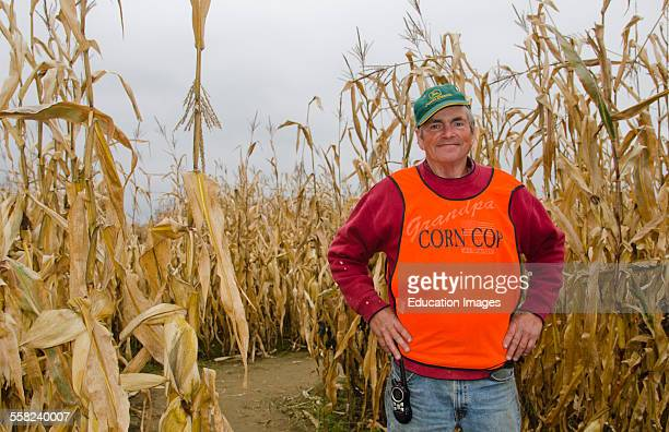 Farmington Maine fall activity Corn Maze in field with corn stalks and man in charge