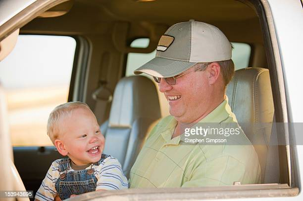 farm/ranch Dad in pickup truck with his small son