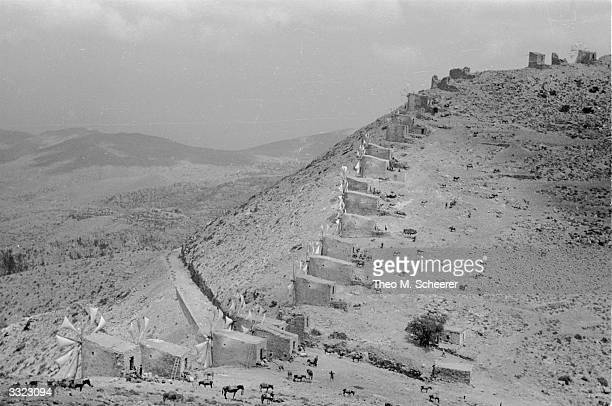 Farms in the valley of Lassithi on the island of Crete The wealth of each farmer is gauged by the number of whitesailled windmills he owns The...