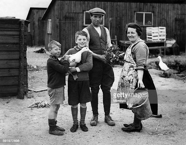 Farms smallholding Mr William Whing with his wife and two of his five sons Kenneth and Derek on their small holding Land Settlement Asscoiation...