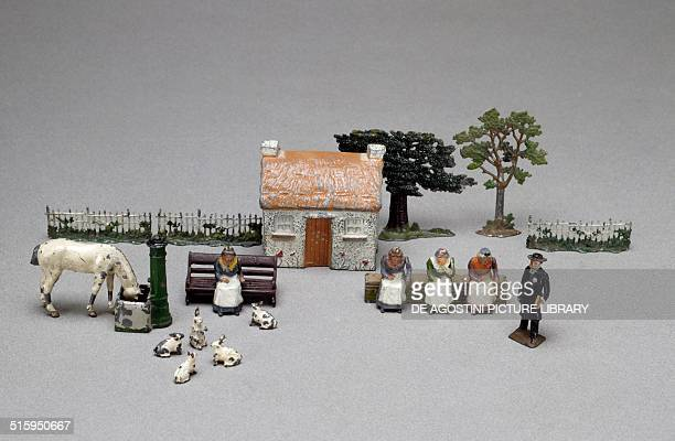 Farmstead with women at work and animals set of figures and objects for farmsteads handpainted hollow cast lead toys made by Britain England 20th...