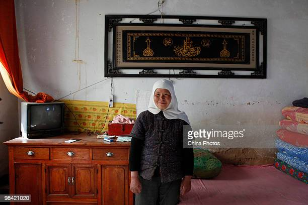 A farmwife poses for a photo at home on March 12 2010 in Xihaigu Tongxin County of Ningxia Hui Autonomous Region north China Xihaigu is the general...