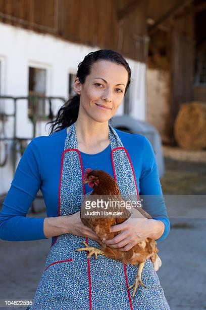 Farmwoman with hen
