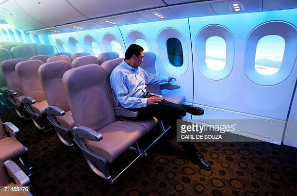 A man tests an electronic window designed for the Boeing 787 aircraft at The Boeing stand at Farnborough Airshow 16 July 2006 The window relies on a...