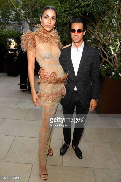 Farnoush Hamidian and John Dodelande attend amfAR Paris Dinner 2018 at The Peninsula Hotel on July 4 2018 in Paris France