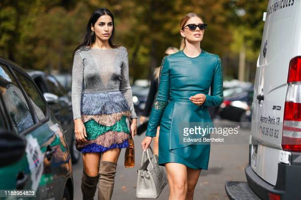 Farnoush Hamidian wears a gray flitter mesh dress with colored ruffles brown suede high boots Stephanie Abrishamchi wears a green leather dress a bag...