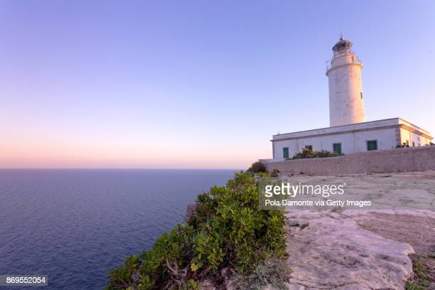 Faro de la Mora in Formentera coastline idyllic beach at sunset, Balearic Islands, Spain