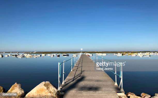 faro, portugal: by the morning at the pier - faro city portugal stock photos and pictures
