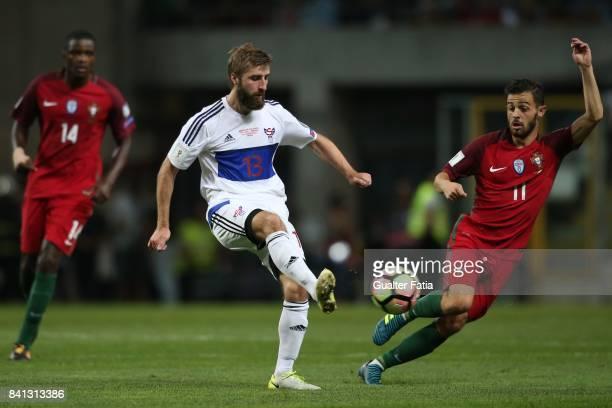 Faroe Island midfielder Roaldur Jakobsen with Portugal midfielder Bernardo Silva in action during the FIFA 2018 World Cup Qualifier match between...