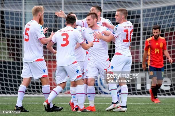 Faroe Islands' forward Klaemint Olsen celebrates with teammates after scoring during the UEFA Euro 2020 group F qualifying football match between...