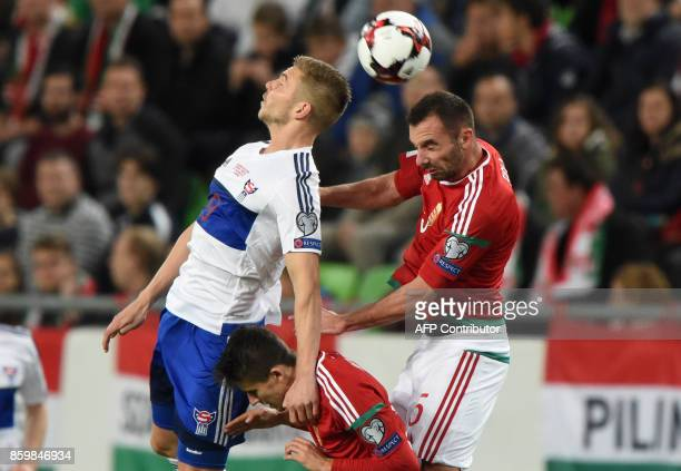Faroe Islands' Gilli Sorensen vies with Hungary's Attila Fiola and Adam Nagy during the FIFA World Cup 2018 qualification football match between...
