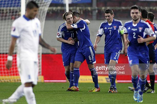 Faroe Island's Joan Edmundsson celebrates with his teammates after scoring a goal during the UEFA Euro 2016 group F qualifying football match between...