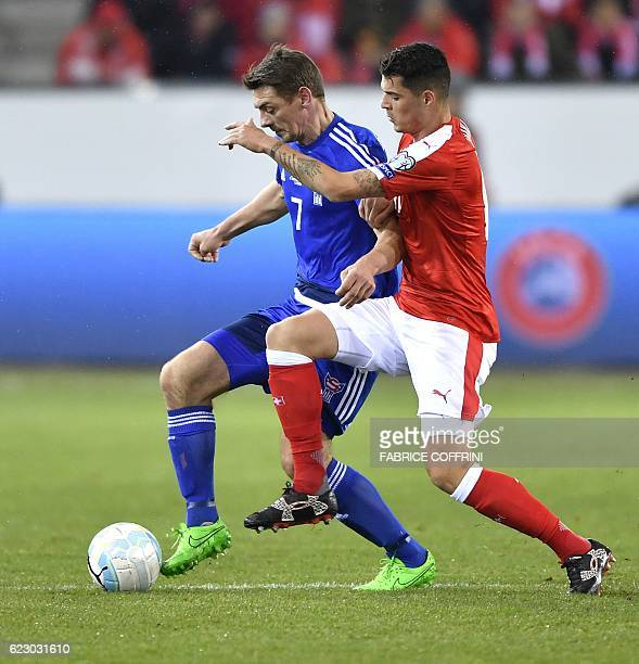 Faroe Islands' mifdielder Frodi Benjaminsen vies with Swiss midfielder Granit Xhaka during the FIFA World Cup 2018 Group B qualifying football match...