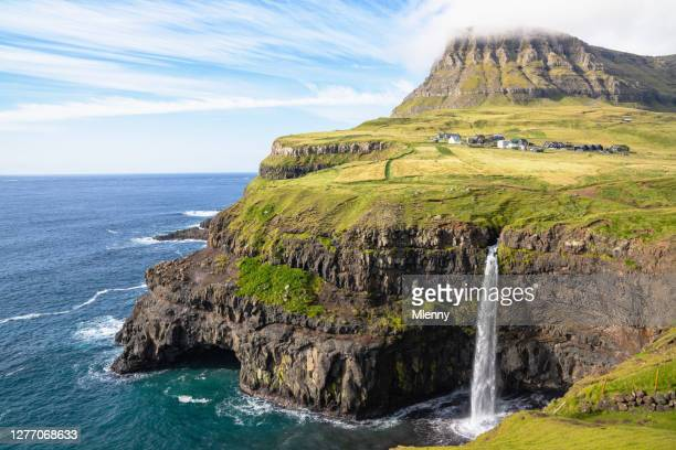 faroe islands mulafossur waterfall and gasadalur village in summer - torshavn stock pictures, royalty-free photos & images
