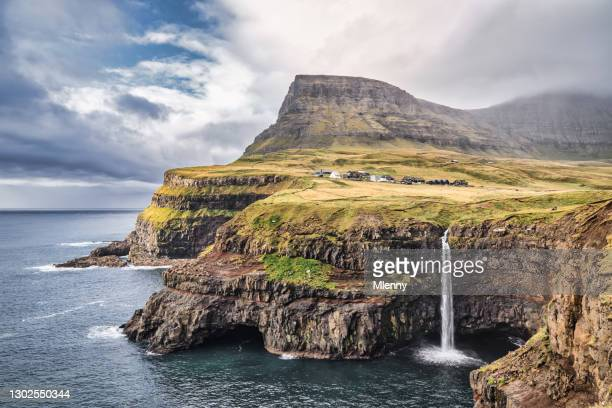 faroe islands mulafossur waterfall dramatic skyscape gasadalur vágar island - mlenny stock pictures, royalty-free photos & images