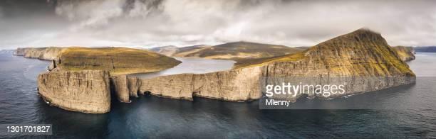faroe islands sørvágsvatn lake above the ocean panorama vágar island - mlenny stock pictures, royalty-free photos & images