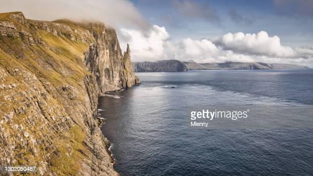 faroe islands trollkonufingur monolith vagar island coast panorama witch finger - mlenny stock pictures, royalty-free photos & images