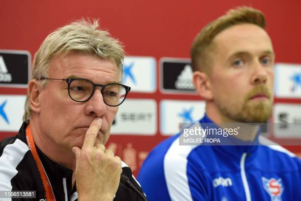 Faroes' coach Lars Olsen and Faroes' goalkeeper Gunnar Nielsen hold a press conference at El Molinon stadium in Gijon on September 7 on the eve of...