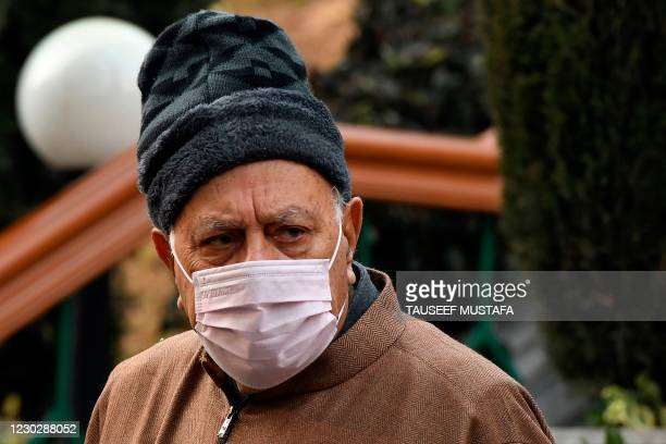 Farooq Abdullah, chairman of Jammu and Kashmir National Conference attends a press conference after a meeting with political leaders at his residence...