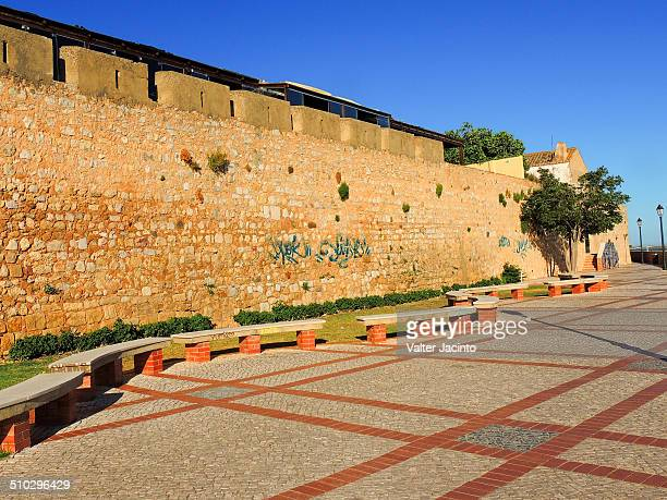 Faro's defensive walls were built by the Moors in the 9th century likely over previous Roman defensive constructions
