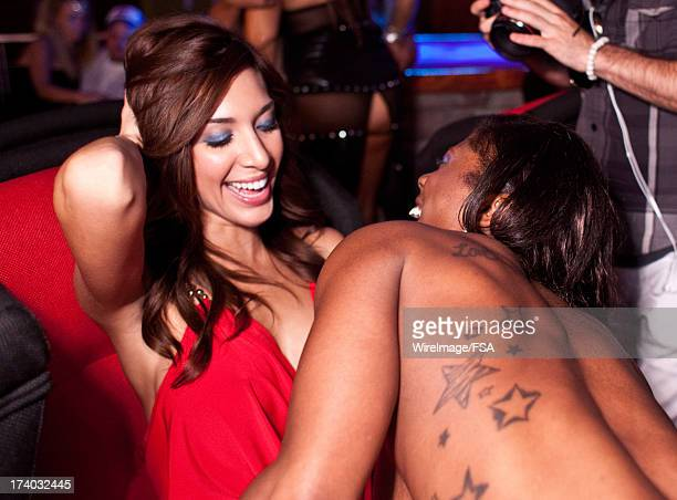 Farrah Abraham gets a lap dance from Priscilla while making an appearance at the new Vivid Gentlemen's Club on July 18 2013 in Mooresville North...